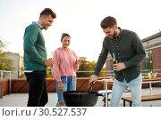 Купить «happy friends having bbq party on rooftop», фото № 30527537, снято 2 сентября 2018 г. (c) Syda Productions / Фотобанк Лори