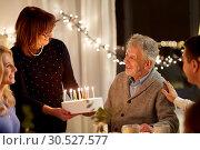 Купить «happy family having birthday party at home», фото № 30527577, снято 15 декабря 2018 г. (c) Syda Productions / Фотобанк Лори