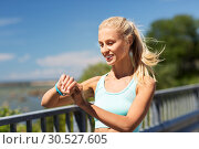 Купить «happy woman with fitness tracker exercising», фото № 30527605, снято 5 июля 2015 г. (c) Syda Productions / Фотобанк Лори