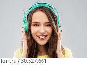 Купить «happy young woman or teenage girl with headphones», фото № 30527661, снято 29 января 2019 г. (c) Syda Productions / Фотобанк Лори