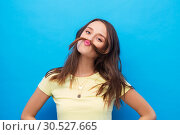 Купить «young woman making mustache with her hair», фото № 30527665, снято 29 января 2019 г. (c) Syda Productions / Фотобанк Лори