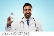 Купить «indian male doctor with pills and stethoscope», фото № 30527693, снято 12 января 2019 г. (c) Syda Productions / Фотобанк Лори