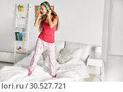 Купить «happy woman in headphones having fun at home», фото № 30527721, снято 14 ноября 2015 г. (c) Syda Productions / Фотобанк Лори