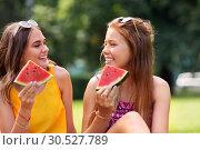 Купить «teenage girls eating watermelon at picnic in park», фото № 30527789, снято 19 июля 2018 г. (c) Syda Productions / Фотобанк Лори