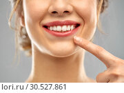 Купить «close up of woman pointing to her white teeth», фото № 30527861, снято 20 января 2019 г. (c) Syda Productions / Фотобанк Лори