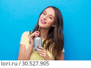 Купить «young woman or teenage girl drinking soda from can», фото № 30527905, снято 29 января 2019 г. (c) Syda Productions / Фотобанк Лори