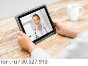 Купить «senior woman patient having video call with doctor», фото № 30527913, снято 10 июля 2015 г. (c) Syda Productions / Фотобанк Лори
