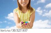 Купить «close up of girl holding chocolate easter eggs», фото № 30527937, снято 25 июля 2018 г. (c) Syda Productions / Фотобанк Лори