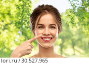 Купить «beautiful young woman pointing to her nose», фото № 30527965, снято 20 января 2019 г. (c) Syda Productions / Фотобанк Лори