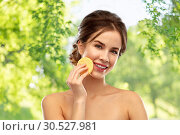 Купить «young woman cleaning face with exfoliating sponge», фото № 30527981, снято 20 января 2019 г. (c) Syda Productions / Фотобанк Лори