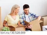 Купить «happy couple unpacking boxes at new home», фото № 30528009, снято 25 февраля 2016 г. (c) Syda Productions / Фотобанк Лори