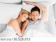 Купить «happy couple sleeping in bed at home», фото № 30528013, снято 25 февраля 2016 г. (c) Syda Productions / Фотобанк Лори