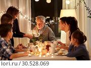 Купить «happy family having birthday party at home», фото № 30528069, снято 15 декабря 2018 г. (c) Syda Productions / Фотобанк Лори