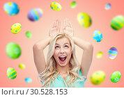 Купить «happy smiling young woman making easter bunny ears», фото № 30528153, снято 13 февраля 2016 г. (c) Syda Productions / Фотобанк Лори