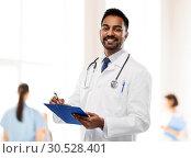 Купить «indian male doctor with clipboard and stethoscope», фото № 30528401, снято 12 января 2019 г. (c) Syda Productions / Фотобанк Лори