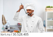 Купить «indian chef tasting food from ladle at kitchen», фото № 30528405, снято 12 января 2019 г. (c) Syda Productions / Фотобанк Лори