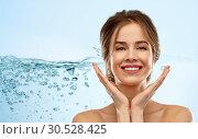 Купить «smiling young woman over blue background», фото № 30528425, снято 20 января 2019 г. (c) Syda Productions / Фотобанк Лори