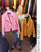 Купить «blonde choosing leather jacket on racks», фото № 30528537, снято 5 сентября 2018 г. (c) Яков Филимонов / Фотобанк Лори
