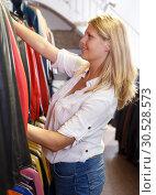 Купить «Woman choosing leather jacket», фото № 30528573, снято 5 сентября 2018 г. (c) Яков Филимонов / Фотобанк Лори