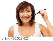 Купить «smiling senior woman with make up blush brush», фото № 30528625, снято 8 февраля 2019 г. (c) Syda Productions / Фотобанк Лори