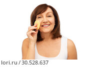 Купить «woman cleaning face with exfoliating sponge», фото № 30528637, снято 8 февраля 2019 г. (c) Syda Productions / Фотобанк Лори