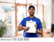 Купить «happy indian delivery man with clipboard at office», фото № 30528685, снято 12 января 2019 г. (c) Syda Productions / Фотобанк Лори