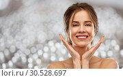 Купить «smiling young woman over grey background», фото № 30528697, снято 20 января 2019 г. (c) Syda Productions / Фотобанк Лори