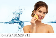 Купить «young woman cleaning face with exfoliating sponge», фото № 30528713, снято 20 января 2019 г. (c) Syda Productions / Фотобанк Лори