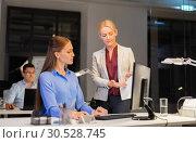 Купить «businesswomen discussing charts at night office», фото № 30528745, снято 6 декабря 2017 г. (c) Syda Productions / Фотобанк Лори