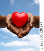 Купить «female hands with small red heart», фото № 30528877, снято 12 декабря 2013 г. (c) Syda Productions / Фотобанк Лори