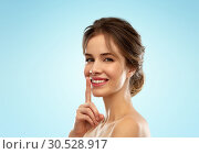 Купить «beautiful smiling woman making hush gesture», фото № 30528917, снято 20 января 2019 г. (c) Syda Productions / Фотобанк Лори