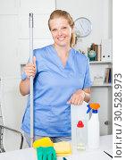 Купить «Woman professional cleaner standing in office», фото № 30528973, снято 21 апреля 2019 г. (c) Яков Филимонов / Фотобанк Лори