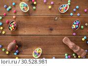 Купить «chocolate eggs, easter bunny and candies on wood», фото № 30528981, снято 22 марта 2018 г. (c) Syda Productions / Фотобанк Лори