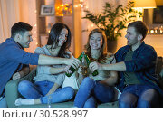 Купить «friends clinking drinks at home in evening», фото № 30528997, снято 22 декабря 2018 г. (c) Syda Productions / Фотобанк Лори