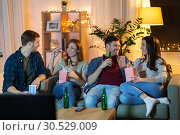 Купить «friends with beer and popcorn watching tv at home», фото № 30529009, снято 22 декабря 2018 г. (c) Syda Productions / Фотобанк Лори