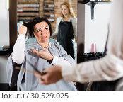 Купить «Angry woman telling to hairdresser that she does not like her hairstyle», фото № 30529025, снято 7 марта 2017 г. (c) Яков Филимонов / Фотобанк Лори