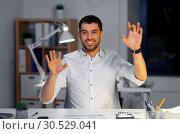Купить «businessman using gestures at night office», фото № 30529041, снято 25 января 2019 г. (c) Syda Productions / Фотобанк Лори
