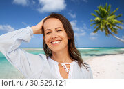 Купить «happy smiling woman on summer beach», фото № 30529121, снято 15 июня 2018 г. (c) Syda Productions / Фотобанк Лори