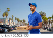 Купить «happy indian delivery man with pizza boxes in blue», фото № 30529133, снято 12 января 2019 г. (c) Syda Productions / Фотобанк Лори