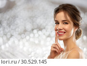 Купить «beautiful smiling woman making hush gesture», фото № 30529145, снято 20 января 2019 г. (c) Syda Productions / Фотобанк Лори