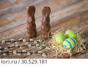 Купить «easter eggs, chocolate bunnies and pussy willow», фото № 30529181, снято 22 марта 2018 г. (c) Syda Productions / Фотобанк Лори