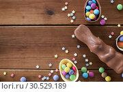 Купить «chocolate eggs, easter bunny and candies on wood», фото № 30529189, снято 22 марта 2018 г. (c) Syda Productions / Фотобанк Лори