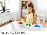 Купить «girl coloring easter eggs by liquid dye at home», фото № 30529197, снято 25 июля 2018 г. (c) Syda Productions / Фотобанк Лори