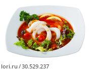 Купить «Spicy tomato soup with sea squids and greens served in a white bowl», фото № 30529237, снято 15 июня 2019 г. (c) Яков Филимонов / Фотобанк Лори