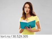 Купить «teenage student girl with diary or notebook», фото № 30529305, снято 29 января 2019 г. (c) Syda Productions / Фотобанк Лори