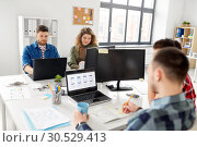 Купить «creative team working on user interface at office», фото № 30529413, снято 1 апреля 2018 г. (c) Syda Productions / Фотобанк Лори
