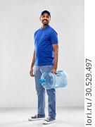Купить «happy indian delivery man with water barrel», фото № 30529497, снято 12 января 2019 г. (c) Syda Productions / Фотобанк Лори