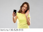 Купить «smiling teenage girl having video call smartphone», фото № 30529513, снято 29 января 2019 г. (c) Syda Productions / Фотобанк Лори