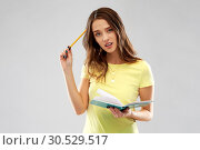 Купить «teenage student girl with diary or notebook thinks», фото № 30529517, снято 29 января 2019 г. (c) Syda Productions / Фотобанк Лори
