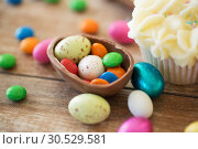 Купить «close up of chocolate egg with candies and cupcake», фото № 30529581, снято 15 марта 2018 г. (c) Syda Productions / Фотобанк Лори